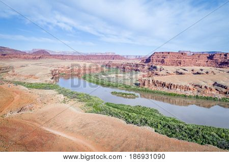 aerial view of the canyon of Colorado River near Moab, Utah, with a jeep trail and camp