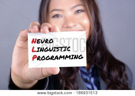 Neuro Linguistic Programming (or NLP) message on the card shown by a woman