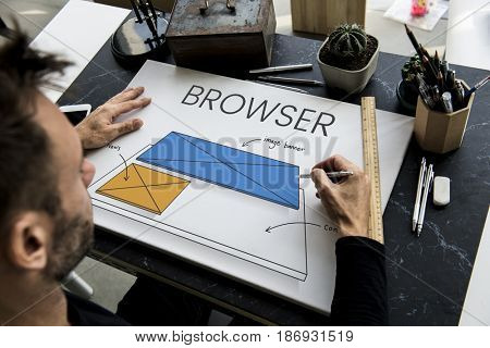 Man working on billboard network graphic overlay on table
