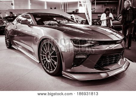STUTTGART GERMANY - MARCH 03 2017: Muscle car The Chevrolet Camaro SS (sixth generation) 2016. Stylization. Toning. Europe's greatest classic car exhibition