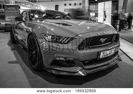 STUTTGART GERMANY - MARCH 03 2017: Pony car Ford Mustang GT AM1 Fastback Coupe 2016. Black and white. Europe's greatest classic car exhibition