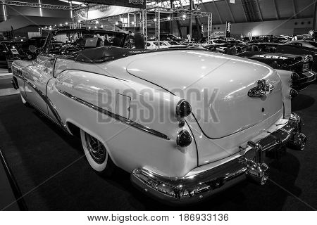 STUTTGART GERMANY - MARCH 03 2017: Full-size car Buick Super Convertible 1953. Rear view. Black and white. Europe's greatest classic car exhibition