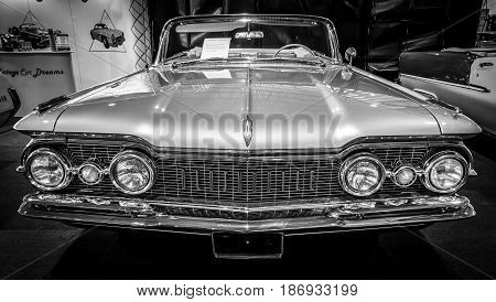 STUTTGART GERMANY - MARCH 03 2017: Full-size car Oldsmobile Super 88 Convertible 1959. Black and white. Europe's greatest classic car exhibition