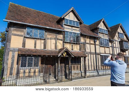 Stratford-upon-Avon United Kingdom - 7 April 2017 - An unidentified man takes a picture of Shakespeare's birth house in Stratford-upon-Avon United Kingdom on April 7th 2017