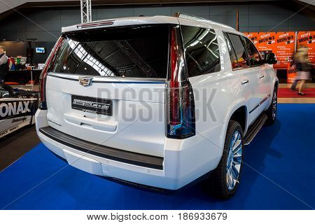 STUTTGART GERMANY - MARCH 03 2017: Full-size luxury SUV Cadillac Escalade Platinum 2017. Rear view. Europe's greatest classic car exhibition