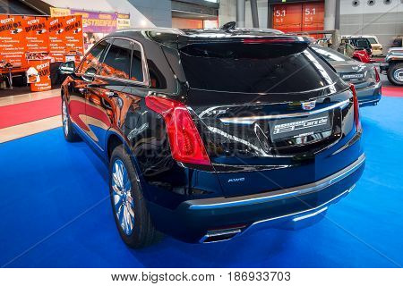 STUTTGART GERMANY - MARCH 03 2017: Mid-size luxury crossover SUV Cadillac XT5 Platinum 2017. Rear view. Europe's greatest classic car exhibition