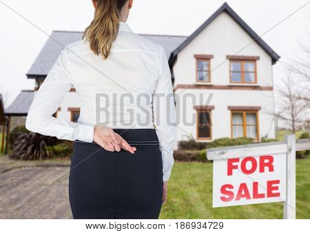 Digital composite of Property seller woman with her fingers crossed