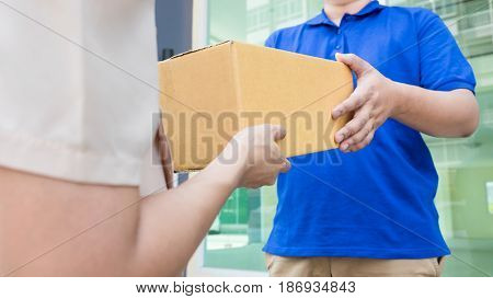 Postal - Delivery Of A Package Through A  Service; Woman Customer Hand Accepting Receipt Cardboard B