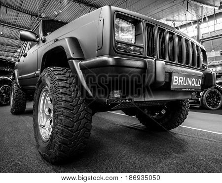 STUTTGART GERMANY - MARCH 03 2017: A fully capable off road SUV Jeep Cherokee (XJ) LTD 2000. Black and white. Europe's greatest classic car exhibition