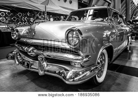 STUTTGART GERMANY - MARCH 03 2017: Mid-size luxury car Ford Mainline 1953. Black and white. Europe's greatest classic car exhibition