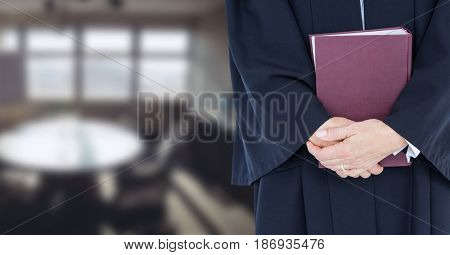Digital composite of Judge holding book in front of office room