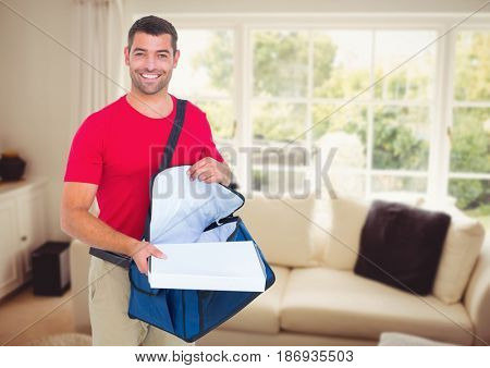 Digital composite of Happy deliveryman with the delivery bag and boxes in the livingroom