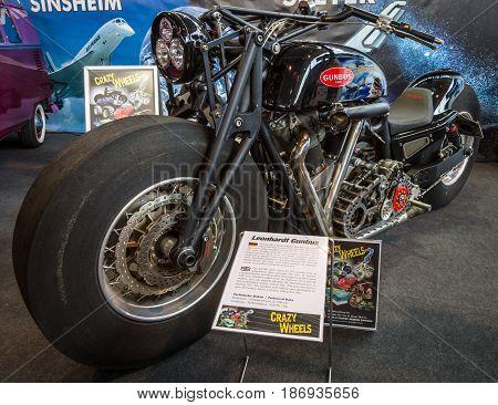 STUTTGART GERMANY - MARCH 03 2017: The world's biggest running motorcycle Leonhardt Gunbus 410. Europe's greatest classic car exhibition