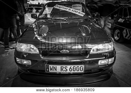 STUTTGART GERMANY - MARCH 03 2017: Rally special car Ford Escort RS Cosworth 1993. Black and white. Europe's greatest classic car exhibition