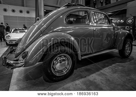 STUTTGART GERMANY - MARCH 03 2017: Subcompact Volkswagen Beetle 1973. Rear view. Black and white. Europe's greatest classic car exhibition