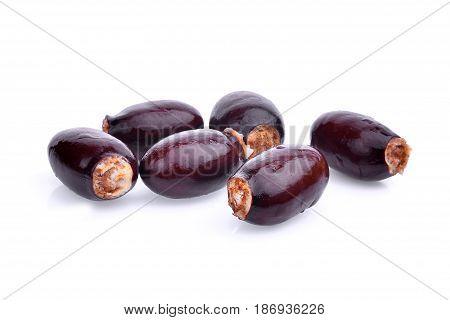 seeds of lychee fruit isolated on white background