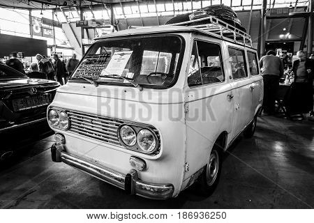 STUTTGART GERMANY - MARCH 03 2017: The minibus Fiat 850 Familiare 1964. Black and white. Europe's greatest classic car exhibition