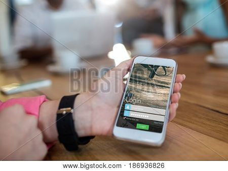Digital composite of hand with watch and phone with login screen in a cafeteria