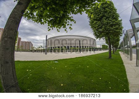 Krasnodar, Russia - May 10, 2016: Dramatic sky and park green trees in front of the new stadium of FC Krasnodar on May 10, 2017