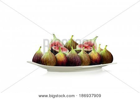 Close-up image of purple figs on a plate studio isolated on white background