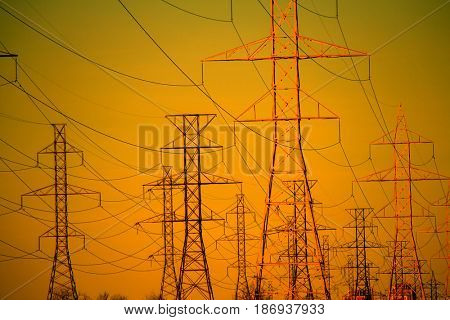 Image of power lines towers at sunset