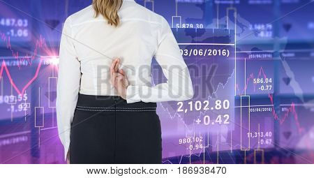 Digital composite of stock market, Business woman with her fingers crossed