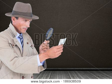 Digital composite of Detective with magnifying glass in front of blackboard