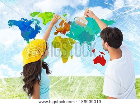 Digital composite of Couple painting Colorful Map with bright sky background