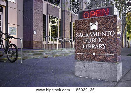 SACRAMENTO, CALIFORNIA, USA - November 14, 2009: Neon sign outside the downtown Sacramento Public Library indicates the library is open for business