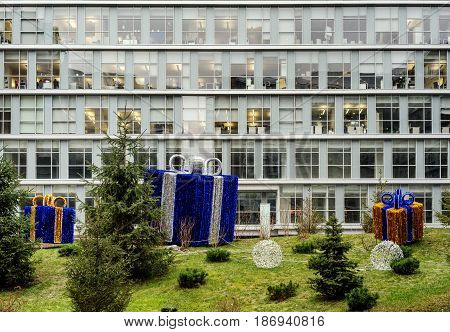 Christmas decoration in the center of the city park on the background buildings business center