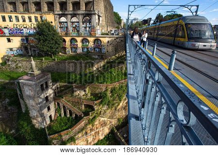 PORTO, PORTUGAL - MAY 17, 2017: Abandoned buildings in the old part of city. Porto is home to the Porto School of Architecture, one of the most prestigious architecture schools in the world.