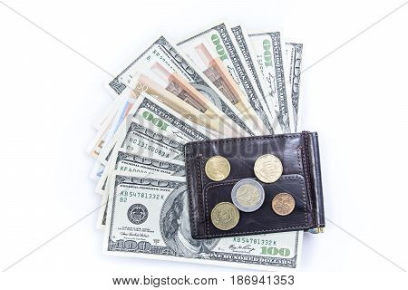 Coins and banknotes in a purse isolated on white background