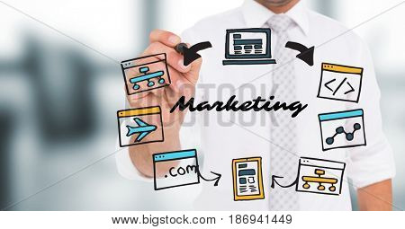 Digital composite of Business man mid section with marker behind marketing doodles in blurry grey office