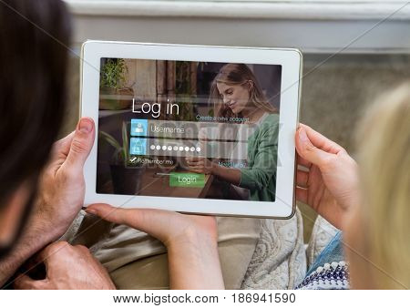 Digital composite of Couple with tablet in login screen