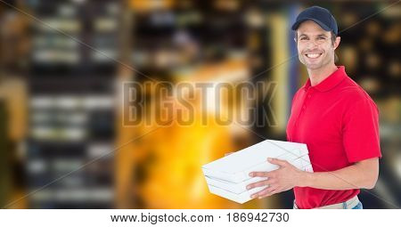 Digital composite of Happy delivery man holding pizza boxes