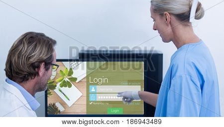 Digital composite of Medical staff looking at signup page on monitor