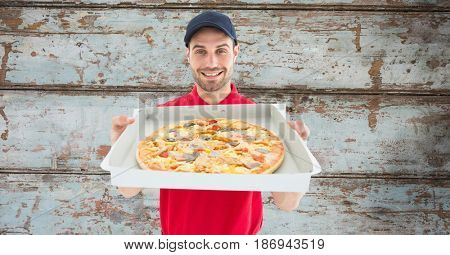 Digital composite of Delivery man showing pizza