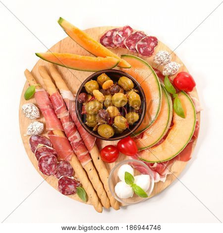 antipasti with melon, salami and olive
