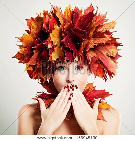 Surprised Woman with Autumn Leaves. Surprise and Fun