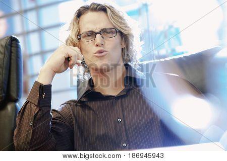 Caucasian businessman grimacing