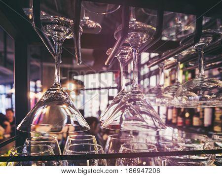 Wine Glasses hanging on rack Cocktails drink Bar Pub Restaurant Party