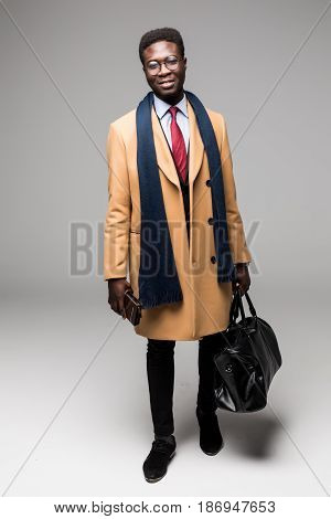 African American Businessman Travel With Bag In Coat Isolated