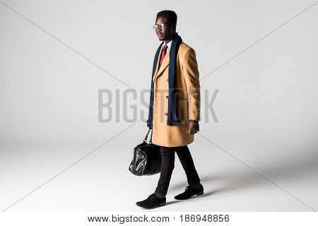 African Businessman With Bag Isolated On White