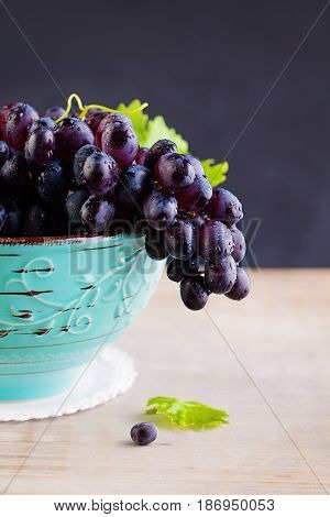 Grape with Green Leaves on Vintage Background