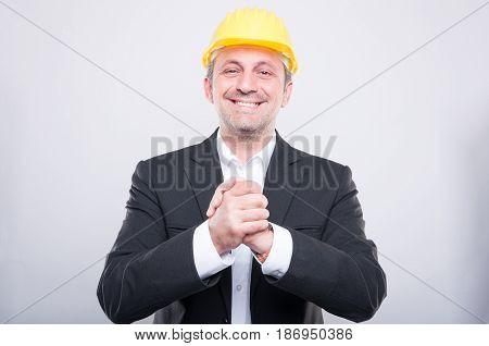 Handsome Contractor Wearing Helmet Gesturing Hand Shake