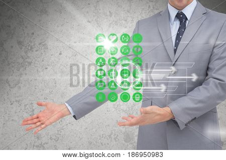 Digital composite of Digital composite image of various icons with businessman gesturing in background