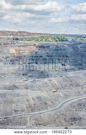 Iron ore opencast mining site on a hot summer day