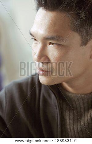 Serious Asian man
