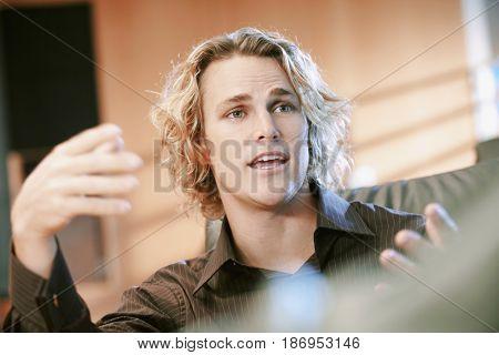 Caucasian businessman talking and gesturing