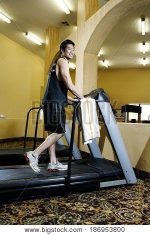 Asian man exercising in health club